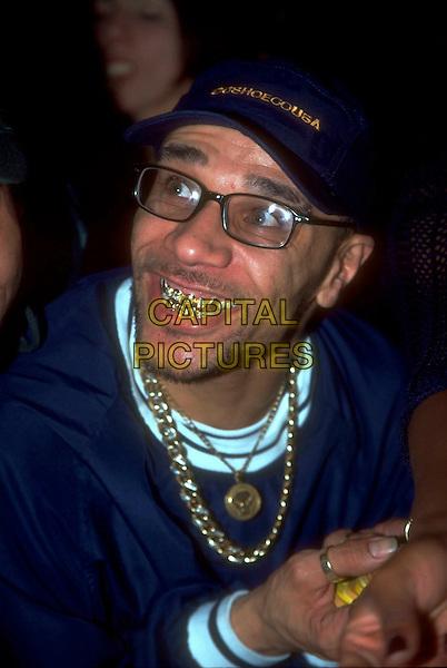 GOLDIE.Ref: JM4722.headshot portrait glasses blue baseball cap hat teeth gold necklaces.www.capitalpictures.com.sales@capitalpictures.com.©James McCauley/Capital Picturesc