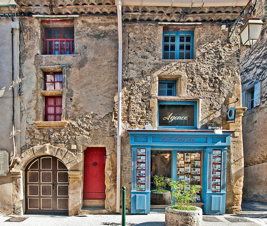 Façades of two adjoining buildings in the village of Lourmarin.