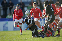 New Zealand loose head Rodney Ah You from this tackle to Peter Saili during the Division A clash against Wales at Ravenhill. Result New Zealand 37 Wales 14.