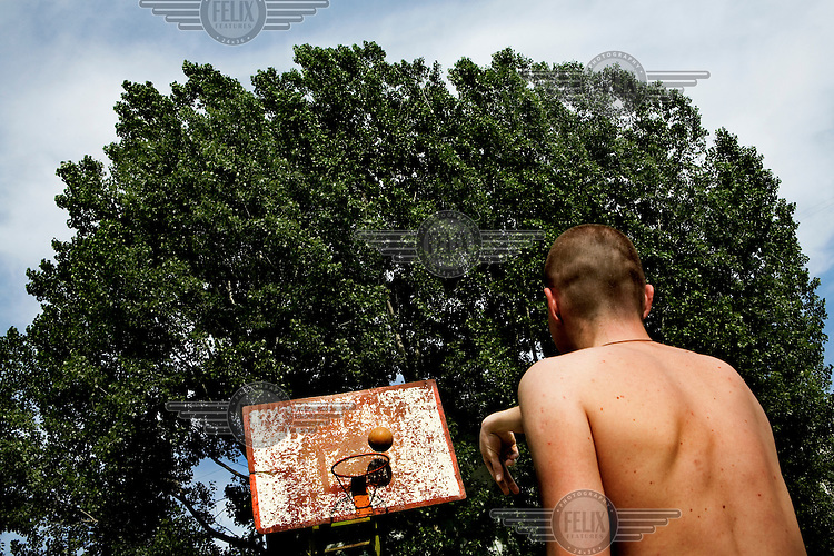 A young man plays basketball in a playground in the capital of Transnistra, Tiraspol. Also known as Trans-Dniestr or Transdniestria, Transnistria, located mostly on a strip of land between the Dniester River and the eastern Moldovan border with Ukraine, broke away from Moldova in 1990 and although a de facto independent state, governed by the Pridnestrovian Moldavian Republic (PMR), is not recognised internationally. ..