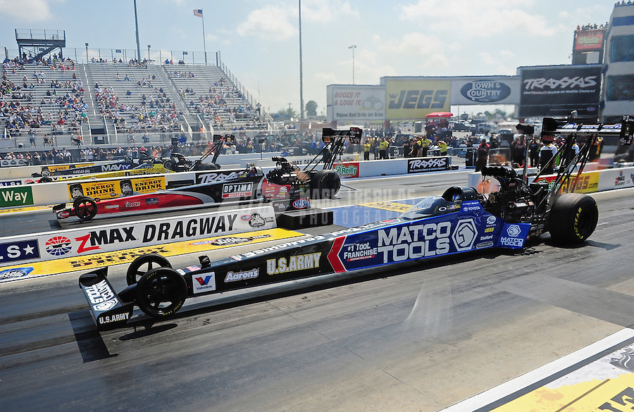 Apr. 15, 2012; Concord, NC, USA: NHRA top fuel dragster drivers (near to far lane) Antron Brown , David Grubnic , Spencer Massey and Brandon Bernstein race four wide during the Four Wide Nationals at zMax Dragway. Mandatory Credit: Mark J. Rebilas-