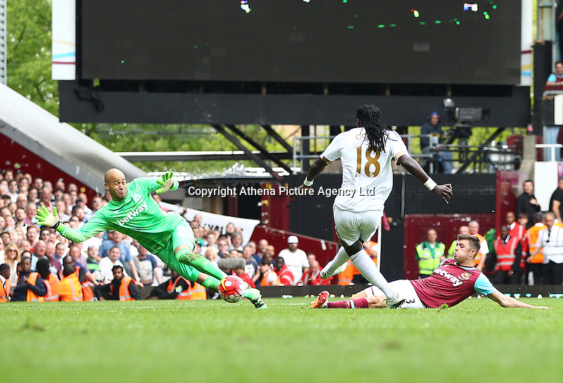 Bafetimbi Gomis of Swansea scores his sides fourth goal past Darren Randolph of West Ham United   during the Barclays Premier League match between West Ham United and Swansea City  played at Boleyn Ground , London on 7th May 2016