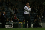 Blackburn Rovers 3, Huddersfield Town 1, 22/09/2005. Ewood Park, Carling Cup. Town manager Peter Jackson trying to attract his players attention during the second half. Photo by Colin McPherson.