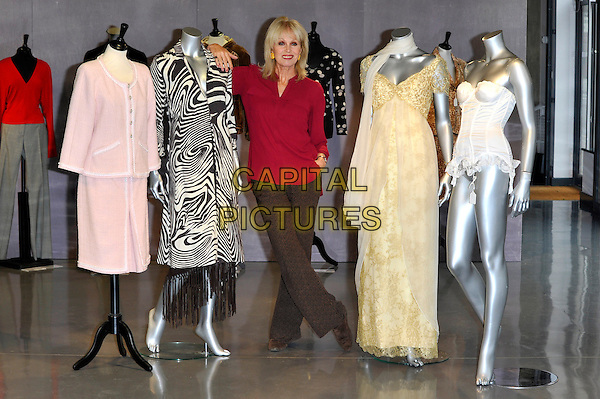 Joanna Lumley.Photocall to promote auction of her clothing worn in various TV programs, held at Kerry Taylor Auctions, Long Lane, Borough, London, England..November 12th, 2012.full length red top brown trousers mannequins pink black white gold dress jacket zebra animal print .CAP/CJ.©Chris Joseph/Capital Pictures.