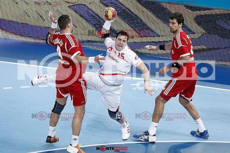 Hungary's Szabolcs Szollosi (l) and Tamas Mocsai (r) and Spain's Carlos Ruesga Pasarin during 23rd Men's Handball World Championship preliminary round match Hungary v Spain.January 17,2013. (ALTERPHOTOS/Acero)