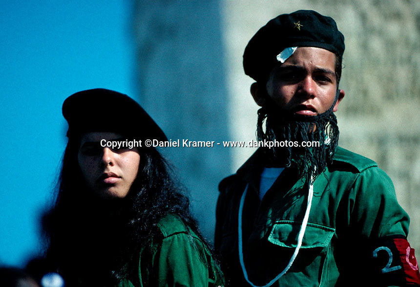 """As part of the homage to the fallen heroes at the Che Guevara mausoleum in Santa Clara in 1998, two children dress up like """"Tania"""" and """"Che""""."""