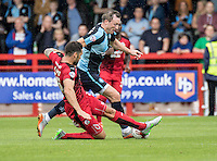 Jon Ashton of Crawley Town tackles Garry Thompson of Wycombe Wanderers during the Sky Bet League 2 match between Crawley Town and Wycombe Wanderers at Checkatrade.com Stadium, Crawley, England on 29 August 2015. Photo by Liam McAvoy.