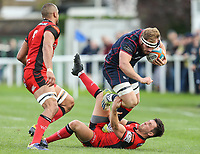 Joe Atkinson of London Scottish is tackled during the Greene King IPA Championship match between London Scottish Football Club and Hartpury RFC at Richmond Athletic Ground, Richmond, United Kingdom on 28 October 2017. Photo by David Horn.