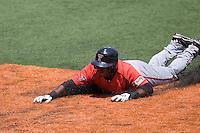 Second baseman Jamodrick McGruder #2 of the Texas Tech Red Raiders slides headfirst into third base on a steal attempt against the Texas Longhorns on April 17, 2011 at UFCU Disch-Falk Field in Austin, Texas. (Photo by Andrew Woolley / Four Seam Images)