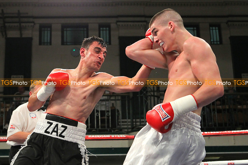 Macaulay McGowan (white shorts) defeats Jamie Zaszlos in a Welterweight boxing contest at York Hall, Bethnal Green, London - 20/09/14 - MANDATORY CREDIT: Gavin Ellis/TGSPHOTO - Self billing applies where appropriate - contact@tgsphoto.co.uk - NO UNPAID USE