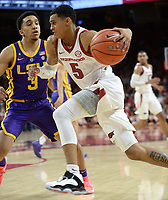 NWA Democrat-Gazette/ANDY SHUPE<br /> Arkansas guard Jalen Harris (5) drives past LSU guard Tremont Waters Friday, Jan. 11, 2019, during the second half of play in Bud Walton Arena in Fayetteville. Visit nwadg.com/photos to see more photographs from the game.