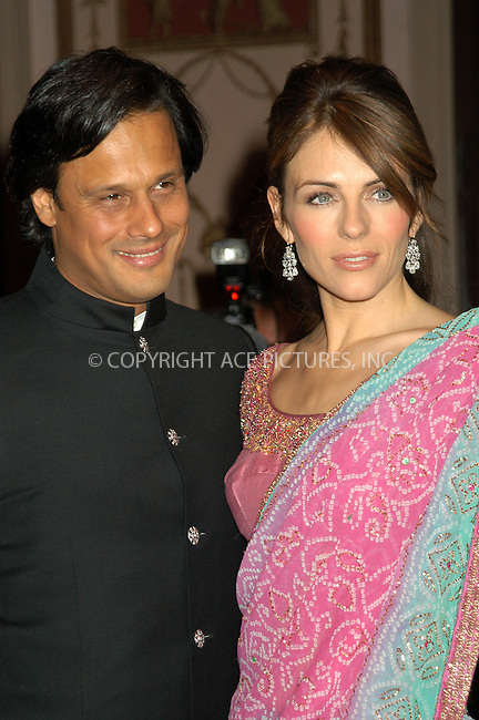 WWW.ACEPIXS.COM . . . . . ....NEW YORK, APRIL 20, 2005....Elizabeth Hurley and Arun Nayar at the Breast Cancer Research Foundation's Annual Red Hot and Pink Party held at the Waldorf Astoria.....Please byline: KRISTIN CALLAHAN - ACE PICTURES.. . . . . . ..Ace Pictures, Inc:  ..Craig Ashby (212) 243-8787..e-mail: picturedesk@acepixs.com..web: http://www.acepixs.com