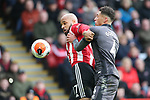 David McGoldrick of Sheffield Utd and Ben Godfrey of Norwich City during the Premier League match at Bramall Lane, Sheffield. Picture date: 7th March 2020. Picture credit should read: Alistair Langham/Sportimage