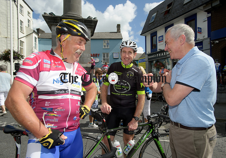 Cyclist Sean Kelly chatting with Gerry Murray and Jim Molloy during the arrival in Ennis of the Tour de Munster, a four day 600km charity cycle in aid of Down Syndrome Ireland. photograph by John Kelly.