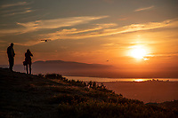 2 people watch bush plane fly in Sumer sunset over Anchorage, Cook Inlet and Mt. Susitna taken from Glenn Alps area<br /> <br /> Photo by Jeff Schultz/SchultzPhoto.com  (C) 2018  ALL RIGHTS RESERVED