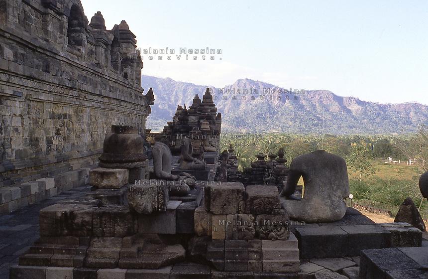 Central Java, Indonesia: detail of The Borobudur temple containing decapitated Buddha statues.<br /> Indonesia, Giava: dettagli del tempio Borobudur con le statue decapitate del Buddha.