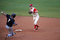 Clearwater Threshers second baseman Derek Campbell (30) turns a double play as Rodrigo Vigil (7) slides in during the first game of a doubleheader against the Jupiter Hammerheads on July 25, 2015 at Bright House Field in Clearwater, Florida.  Jupiter defeated Clearwater 8-5.  (Mike Janes/Four Seam Images)