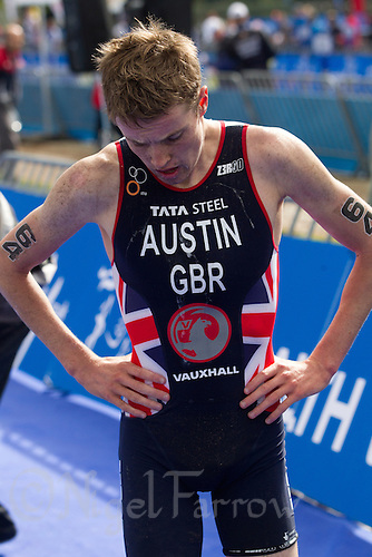 12 SEP 2013 - LONDON, GBR - Marc Austin (GBR) of Great Britain recovers after taking second place at the junior men's ITU 2013 World Triathlon Championships in Hyde Park, London, Great Britain (PHOTO COPYRIGHT © 2013 NIGEL FARROW, ALL RIGHTS RESERVED)