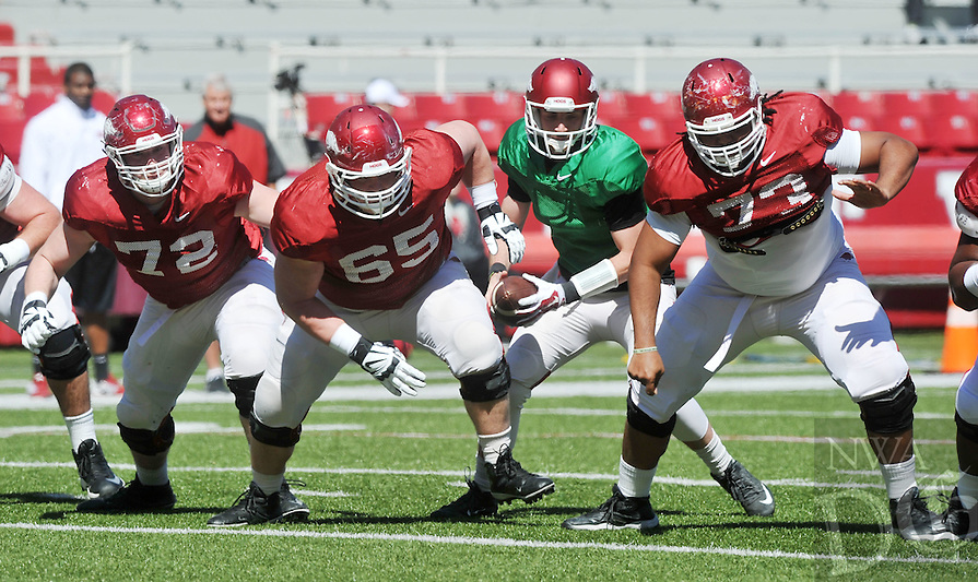 NWA Democrat-Gazette/Michael Woods --04/04/2015- w@NWAMICHAELW... University of Arkansas offensive linemen Frank Ragnow (72) Mitch Smothers (65) and Sebastian Tretola (73) run a play with quarterback Brandon Allen during Saturdays practice at Razorback Stadium in Fayetteville.