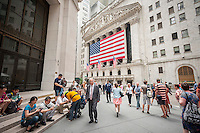 Hordes of tourists and downtown workers in front of the New York Stock Exchange on Wednesday, July 8, 2015. What is being described as a technical problem halted trading on the exchange at 11:32 AM which eventually resumed at about 3:10 PM after being out for about three and one half hours.  (© Richard B. Levine)