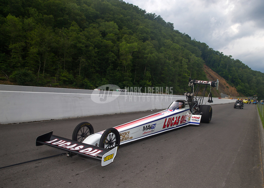 Jun 21, 2015; Bristol, TN, USA; The car of NHRA top fuel champion Richie Crampton being towed back to the Winner's Circle after winning the Thunder Valley Nationals at Bristol Dragway. Mandatory Credit: Mark J. Rebilas-