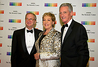 David Bonnet, left, Julie Andrews, center, and Stephen Sauer, right, arrive for the formal Artist's Dinner honoring the recipients of the 40th Annual Kennedy Center Honors hosted by United States Secretary of State Rex Tillerson at the US Department of State in Washington, D.C. on Saturday, December 2, 2017. The 2017 honorees are: American dancer and choreographer Carmen de Lavallade; Cuban American singer-songwriter and actress Gloria Estefan; American hip hop artist and entertainment icon LL COOL J; American television writer and producer Norman Lear; and American musician and record producer Lionel Richie. Photo Credit: Ron Sachs/CNP/AdMedia