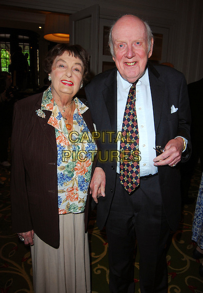 PAMELA CUNDELL & GUEST.June Brown Tribute Luncheon, Grosvenor House, London, UK..October 15th, 2006.Ref: CAN.half length black suit floral print top brown jacket.www.capitalpictures.com.sales@capitalpictures.com.©Can Nguyen/Capital Pictures