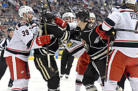 HERSHEY, PA - JANUARY 05: Grand Rapids Griffins defenseman Dylan McIlrath (52) punches Hershey Bears left wing Shane Gersich (10) in the face while Grand Rapids Griffins left wing Derek Hulak (39) and Hershey Bears right wing Beck Malenstyn (13) close in during the Grand Rapids Griffins vs. Hershey Bears AHL game at the Giant Center in Hershey, PA. (Photo by Randy Litzinger/Icon Sportswire)