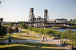 The view of the Willamette River and Tom McCall Waterfront Park from the Burnside Bridge in downtown Portland, Oregon