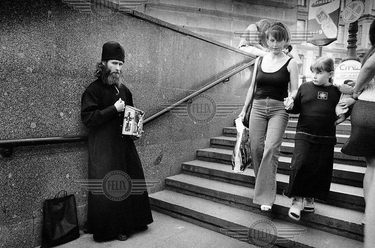 Russian Orthodox priest begging at the entrance to Nevsky Prospect metro station.  ..
