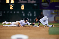 Lancaster JetHawks right fielder Willie Abreu (13) keeps his hand on the bag to avoid being tagged out by Luis Alejandro Basabe (35) during a California League game against the Visalia Rawhide at The Hangar on May 17, 2018 in Lancaster, California. Lancaster defeated Visalia 11-9. (Zachary Lucy/Four Seam Images)
