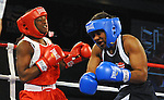 Feb 18 2012; Airway Heights, WA, USA; Claressa Shields (red) has her mouth piece knocked out by Tika Hemingway (blue) during the middleweight bout of US Women's Olympic Boxing Trial Finals at the Northern Quest Resort. Mandatory Credit: James Snook-US PRESSWIRE