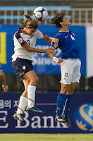 USWNT midfielder (13) Tobin Heath goes up for a header against Italy's (4) Alessia Tuttino during the last group stage game at the Peace Queen Cup.  The USWNT defeated Italy, 2-0, at the Suwon Sports Center in Suwon, South Korea.