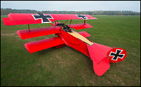 BNPS.co.uk (01202 558833)<br /> Pic: PhilYeomans/BNPS<br /> <br /> Dreaded Red Baron to fly again...WW1 Ace's feared 'Fokker Dreidecker' to finally fly over Britain.<br /> <br /> A German GP based in Norfolk has spent 8 years building a Fokker triplane in his garage as a tribute to infamous WW1 Ace Manfred von Ricthofen, who terrorised the skies over the Western front during the first war.<br /> <br /> Dr Peter Brueggemann, 52, will fulfil his childhood dream and emulate the notorious German fighter pilot when the Dreidecker Dr.1 fighter finally achieves lift-off this summer.<br /> <br /> Dr Brueggemann has even acquired the title Baron from the independent territory of Sealand so he can take to the skies as Baron Peter von Brueggemann in homage to his idol.<br /> <br /> The GP at the Holt Medical Practice in Norfolk hopes to be airborne in a few months once tests on the engine are completed at Felthorpe airfield near Norwich where he has devoted thousands of hours to the project.<br /> <br /> The father-of-two, who has lived in England with wife Sue for 20 years, has been taking flying lessons since his project began.