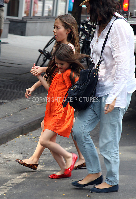 WWW.ACEPIXS.COM . . . . .  ....July 14 2012, New York City....Suri Cruise paid a visit to pet store Citipups in Chelsea on July 14 2012 in New York City....Please byline: PHILIP VAUGHAN - ACE PICTURES.... *** ***..Ace Pictures, Inc:  ..Philip Vaughan (212) 243-8787 or (646) 769 0430..e-mail: info@acepixs.com..web: http://www.acepixs.com