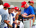 28 September 2010: Philadelphia Phillies' Manager Charlie Manuel signs autographs prior to a game against the Washington Nationals at Nationals Park in Washington, DC. The Nationals defeated the Phillies 2-1 on an Adam Dunn walk-off solo homer in the 9th inning to even up their 3-game series one game apiece. Mandatory Credit: Ed Wolfstein Photo