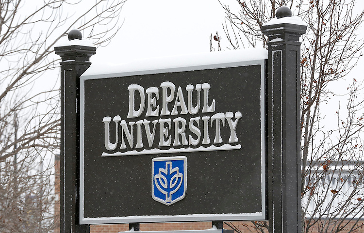 Snow falls on the Lincoln Park campus of DePaul University in Chicago as the New Year brought two days of lake effect snow and ice. (Photo by Jamie Moncrief)