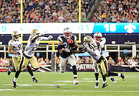 Thursday August 11, 2016: New England Patriots running back Brandon Bolden (38) runs through New Orleans Saints cornerback P.J. Williams (25) anD tight end Garrett Griffin (45) during an NFL pre-season game between the New Orleans Saints and the New England Patriots held at Gillette Stadium in Foxborough Massachusetts. The Patriots defeat the Saints 34-22 in regulation time. Eric Canha/CSM
