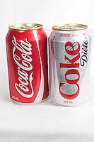 A Coca-cola and coke diete can over a white background