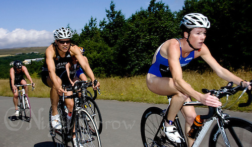 26 JUL 2008 - TREDEGAR, UK - Andrea Whitcombe leads Hollie Avil on the bike - British Elite Triathlon Championships. (PHOTO (C) NIGEL FARROW)