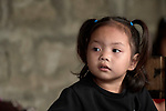 A girl listens to her teacher in a preschool sponsored by the Kapatiran-Kaunlaran Foundation (KKFI) in Pulilan, a village in Bulacan, Philippines.<br /> <br /> KKFI is supported by United Methodist Women.