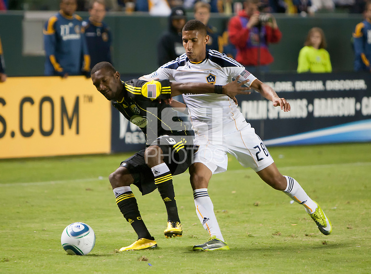 Columbus Crew defender Shaun Francis (29) shields LA Galaxy defender Sean Franklin (28) from the ball during the second half of the game between LA Galaxy and the Columbus Crew at the Home Depot Center in Carson, CA, on September 11, 2010. LA Galaxy 3, Columbus Crew 1.