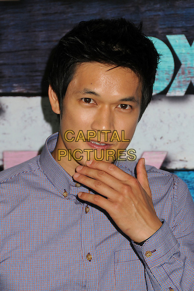 Harry Shum Jr..Fox All-Star Party - Summer 2012 held at Private Location, West Hollywood, California, USA..July 23rd, 2012.headshot portrait purple shirt hand.CAP/ADM/BP.©Byron Purvis/AdMedia/Capital Pictures.