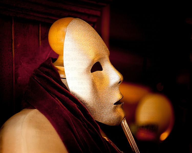 A mask and mannequin in a store window