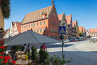 Germany, Bavaria, Middle Franconia, Dinkelsbuehl: historic town at the Romantic Road (theme route), in the red building with crow-stepped gable Emperor Karl V staid overnight in April 1546 | Deutschland, Bayern, Mittelfranken, Dinkelsbuehl: Marktplatz in der historischen Altstadt, in dem roten Haus mit dem Staffelgiebel uebernachtete im April 1546 Kaiser Karl V.