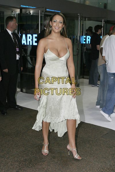 "MODEL - CASIA.""I, Robot"" film premiere arrivals .Odeon Cinema, Leicester Square.London 4th August 2004.CAP/AH.full length, cleavage, crimped, silk, satin skirt.www.capitalpictures.com.sales@capitalpictures.com.©Capital Pictures"
