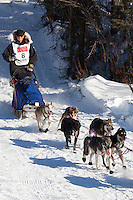Musher Kris Hoffman on Long Lake at the Re-Start of the 2011 Iditarod Sled Dog Race in Willow, Alaska.