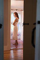 Woman wearing negligee standing in bathroom