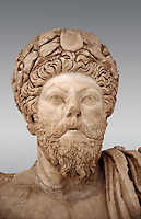 Roman sculpture of the Emperor Marcus Aurelius, excavated from Bulla Regia Theatre, sculpted circa late second century. The Bardo National Museum, Tunis.   Against a grey background.