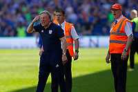 Cardiff City manager Neil Warnock appeals for fans to think after a premature pitch invasion during the Sky Bet Championship match between Cardiff City and Reading at the Cardiff City Stadium, Cardiff, Wales on 6 May 2018. Photo by Mark  Hawkins / PRiME Media Images.